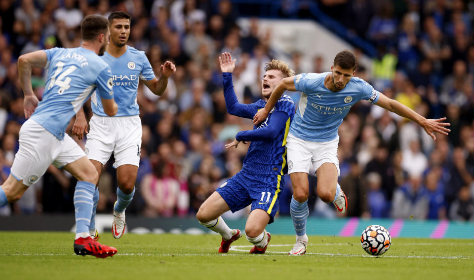 Chelsea's Timo Werner (centre) tussles with Manchester City's Ruben Dias during their Premier League match at Stamford Bridge.