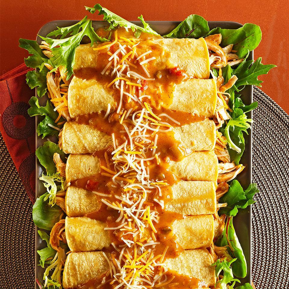 """<p>These easy Mexican enchiladas are filled with flavorful, shredded slow-cooked shredded chicken. Placed on a bed of fresh lettuce, this delicious recipe is sure to be the hit of any dinner occasion. <a href=""""http://www.eatingwell.com/recipe/262838/easy-chicken-enchiladas/"""" rel=""""nofollow noopener"""" target=""""_blank"""" data-ylk=""""slk:View recipe"""" class=""""link rapid-noclick-resp""""> View recipe </a></p>"""