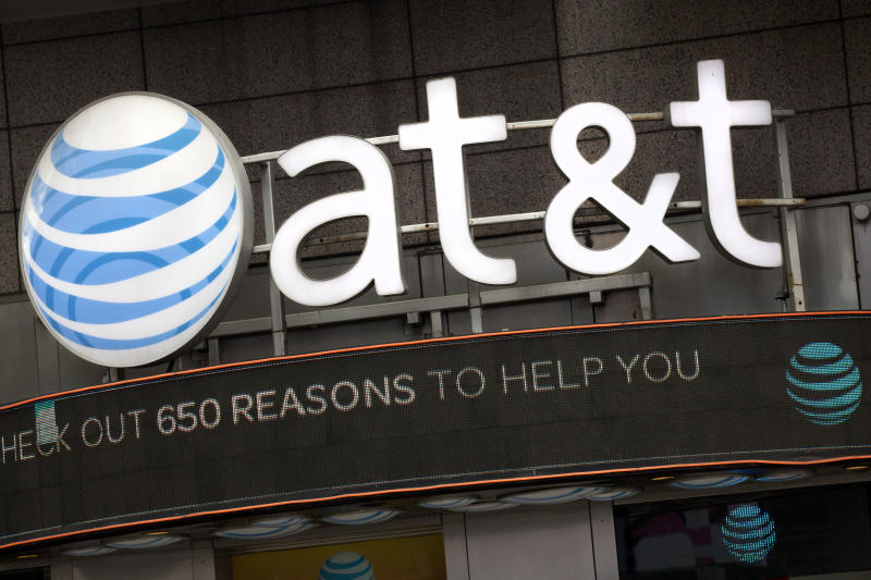 """FILE - In this Oct. 24, 2016, file photo, the AT&T logo is positioned above one of its retail stores in New York. AT&T has drawn ridicule by relabeling the network used by some of its phones as """"5G E"""" to signal that the next-generation wireless network is here. Problem is, phones capable of connecting to 5G aren't coming for another few months, and a national 5G network won't be deployed until 2020 or 2021. (AP Photo/Mark Lennihan, File)"""
