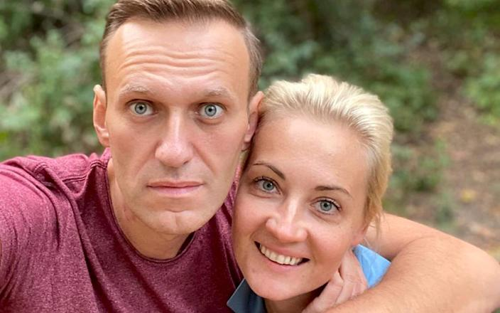 """Alexei Navalny, pictured with his wife Yulia says Angela Merkel went to see him and his family on a """"private"""" visit to his Berlin hospital - Navalny Instagram via AP"""