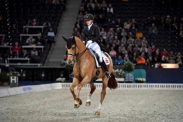 Equestrian - Sweden International Horse Show - Fei Grand Prix Dressage Qualification Event - Friends Arena, Stockholm, Sweden - December 2, 2017. Cathrine Dufour of Denmark rides her horse Atterupgaards Cassidy. TT News Agency/Jessica Gow via REUTERS ATTENTION EDITORS - THIS IMAGE WAS PROVIDED BY A THIRD PARTY. SWEDEN OUT. NO COMMERCIAL OR EDITORIAL SALES IN SWEDEN