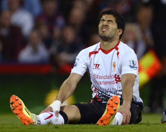 "Liverpool's Luis Suarez reacts during their English Premier League soccer match against Crystal Palace at Selhurst Park in London May 5, 2014. REUTERS/Dylan Martinez (BRITAIN - Tags: SPORT SOCCER) FOR EDITORIAL USE ONLY. NOT FOR SALE FOR MARKETING OR ADVERTISING CAMPAIGNS. NO USE WITH UNAUTHORIZED AUDIO, VIDEO, DATA, FIXTURE LISTS, CLUB/LEAGUE LOGOS OR ""LIVE"" SERVICES. ONLINE IN-MATCH USE LIMITED TO 45 IMAGES, NO VIDEO EMULATION. NO USE IN BETTING, GAMES OR SINGLE CLUB/LEAGUE/PLAYER PUBLICATIONS"