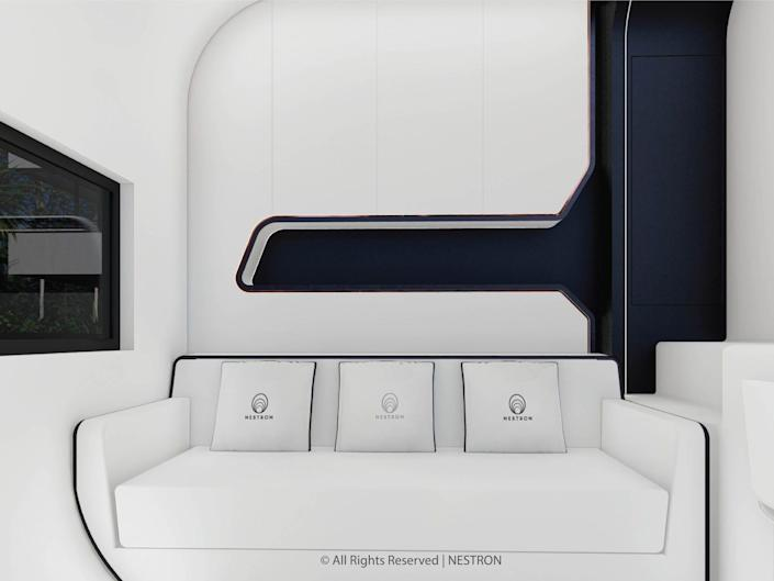 rendering of a couch next to a desk in the two-bedroom Cube Two X