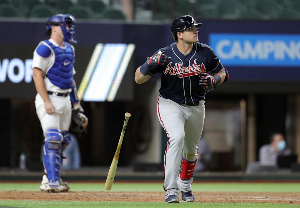 ARLINGTON, TX - OCTOBER 12: Austin Riley #27 of the Atlanta Braves watches his ball after hitting a solo home run in the top of the ninth inning of Game 1 of the NLCS between the Atlanta Braves and the Los Angeles Dodgers at Globe Life Field on Monday, October 12, 2020 in Arlington, Texas. (Photo by Kelly Gavin/MLB Photos via Getty Images)
