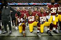 Washington Redskins players during the the national anthem before the game against the Oakland Raiders at FedExField on September 24, 2017 in Landover, Maryland. (Photo by Patrick Smith/Getty Images)