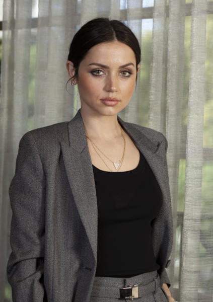 """This Nov. 16, 2019 photo shows actress Ana de Armas posing for a portrait to promote her film """"Knives Out"""" at The Four Seasons Hotel in Los Angeles. (Photo by Rebecca Cabage/Invision/AP)"""
