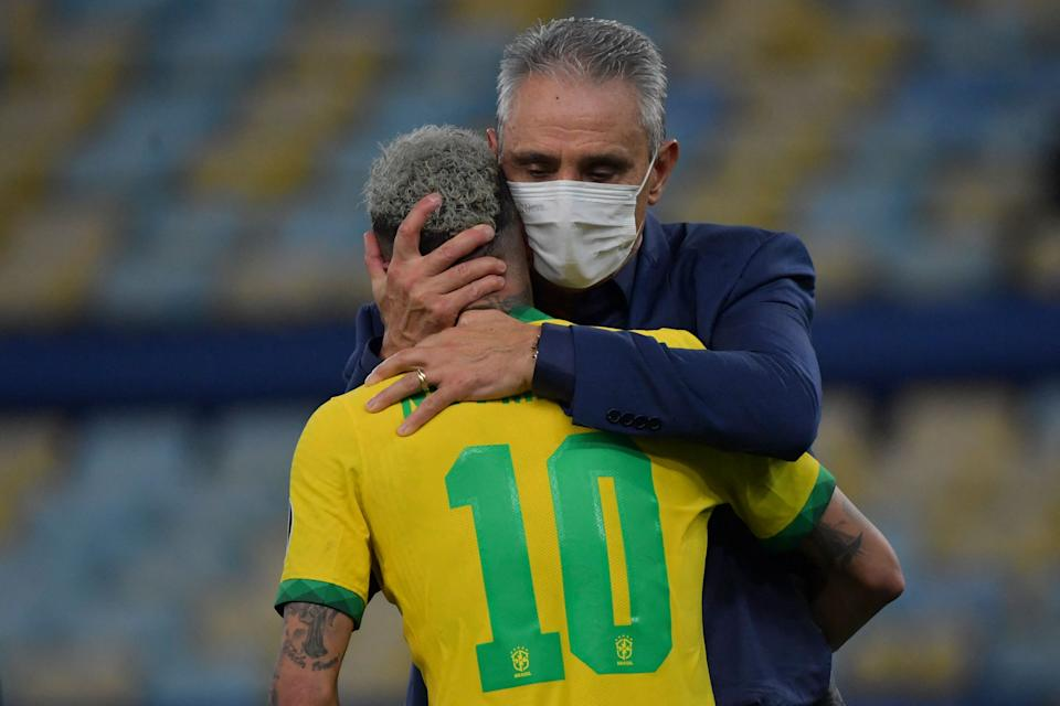 <p>Brazil's Neymar (L) is comforted by Brazil's coach Tite after being defeated 1-0 by Argentina in the Conmebol 2021 Copa America football tournament final match at Maracana Stadium in Rio de Janeiro, Brazil, on July 10, 2021. (Photo by NELSON ALMEIDA / AFP) (Photo by NELSON ALMEIDA/AFP via Getty Images)</p>
