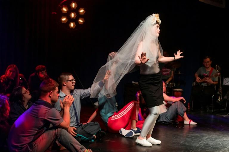 Theatre 21, set up in 2005 by director Justyna Sobczyk for people with Down Syndrome and autism, has brought the parliament protest movement to the stage (AFP Photo/Wojtek RADWANSKI)