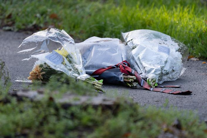Flowers left at the scene after Roberts Bucis was found death. (SWNS)