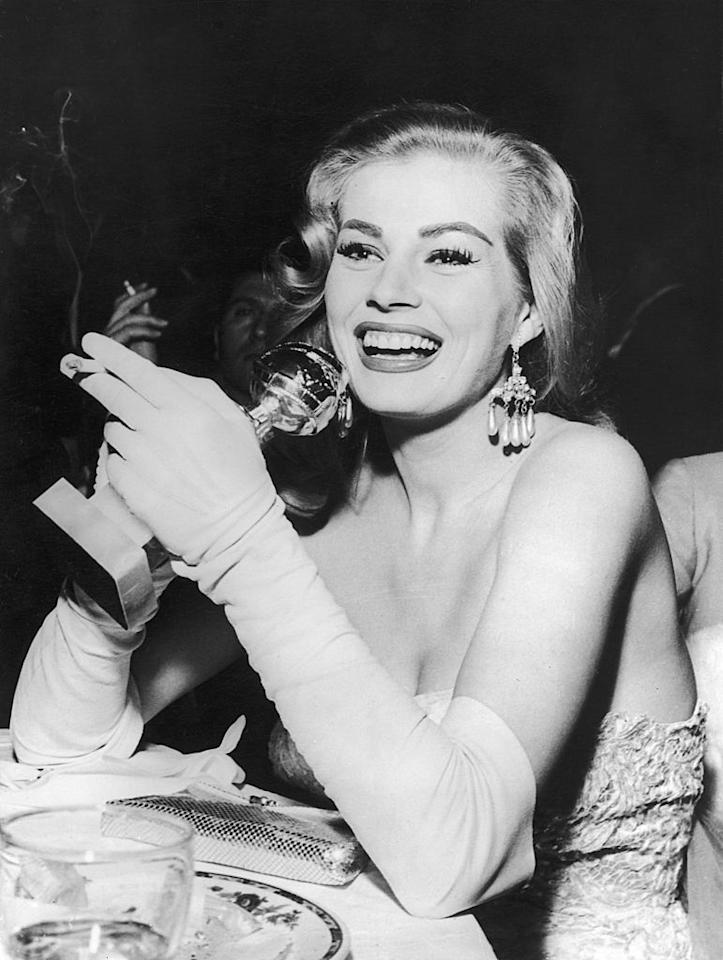 """<p>In 1956, Anita Ekberg won the Best Actress Golden Globe Award for her role in """"Blood Alley,"""" and she was all smiles with her '50s hairdo, superlong lashes, and swipe of lipstick. (Photo by Keystone-France/Gamma-Keystone via Getty Images) </p>"""