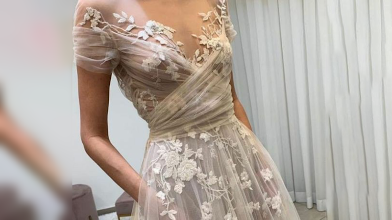 Wedding dress transparent exposes bride's nipples