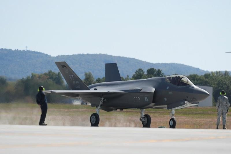 One of the first two F-35 fighter jets arrives at Burlington International Airport on Thursday.