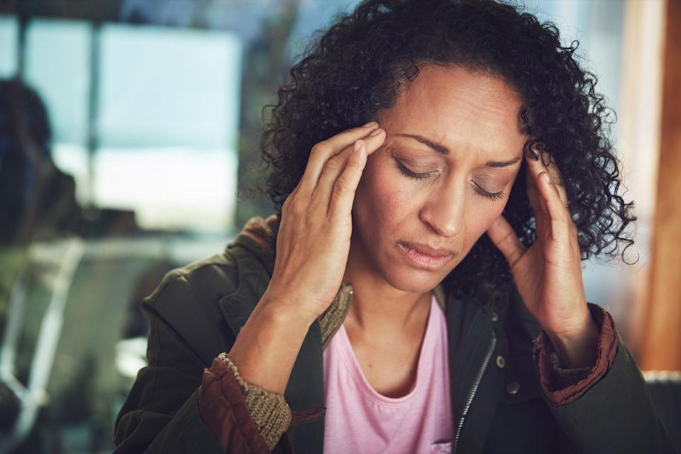 Shot of a mature woman experiencing a headache