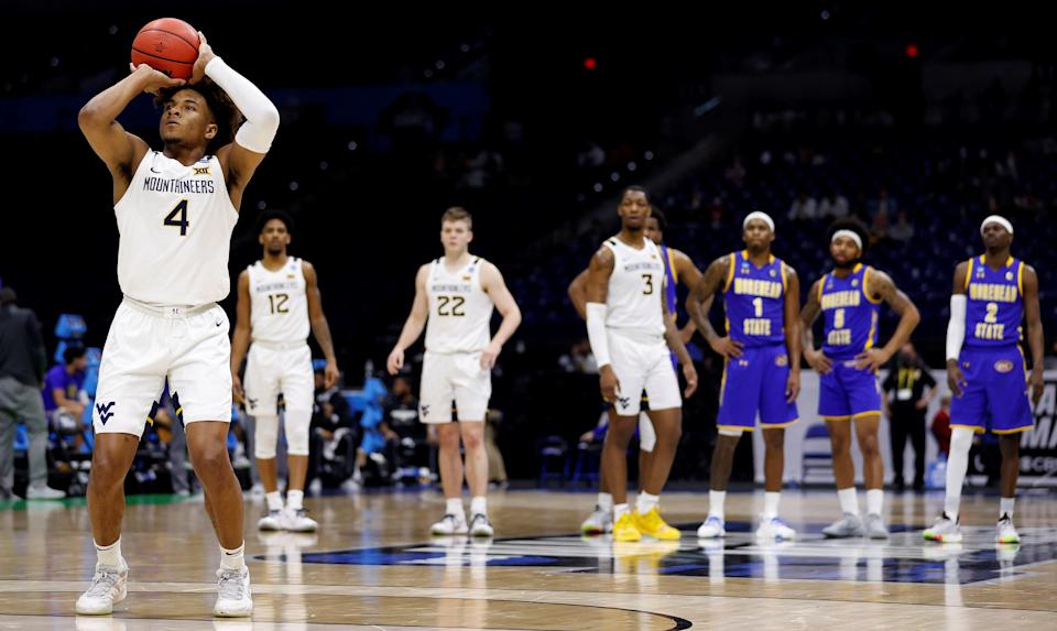 INDIANAPOLIS, INDIANA - MARCH 19: Miles McBride #4 of the West Virginia Mountaineers shoots free throws after a flagrant 1 call against the Morehead State Eagles in the first round game of the 2021 NCAA Men's Basketball Tournament at Lucas Oil Stadium on March 19, 2021 in Indianapolis, Indiana. (Photo by Jamie Squire/Getty Images) ORG XMIT: 775630324 ORIG FILE ID: 1308034165