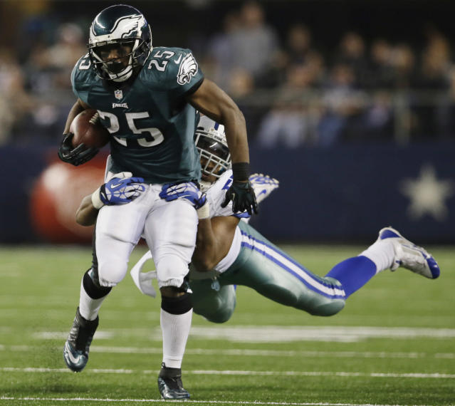 Philadelphia Eagles running back LeSean McCoy (25) is tackled by Dallas Cowboys middle linebacker DeVonte Holloman (57) during the second half of an NFL football game, Sunday, Dec. 29, 2013, in Arlington, Texas. (AP Photo/Tony Gutierrez)