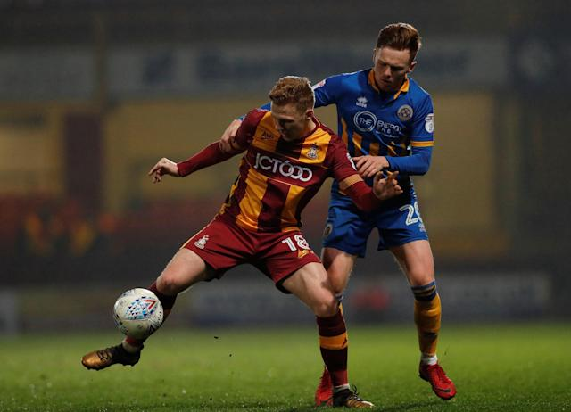 "Soccer Football - League One - Bradford City vs Shrewsbury Town - Northern Commercials Stadium, Bradford, Britain - April 12, 2018 Bradford City's Callum Guy in action with Shrewsbury Town's Jon Nolan Action Images/Lee Smith EDITORIAL USE ONLY. No use with unauthorized audio, video, data, fixture lists, club/league logos or ""live"" services. Online in-match use limited to 75 images, no video emulation. No use in betting, games or single club/league/player publications. Please contact your account representative for further details."