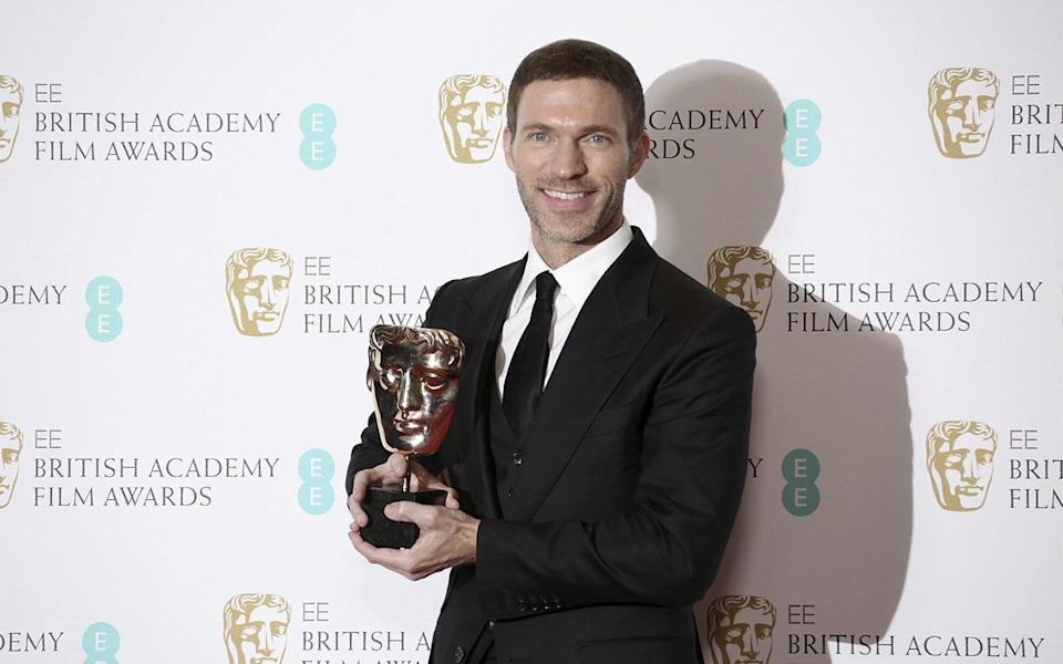 <p>Animator Travis Knight holds his BAFTA award (Credit: Joel Ryan/Invision/AP) </p>