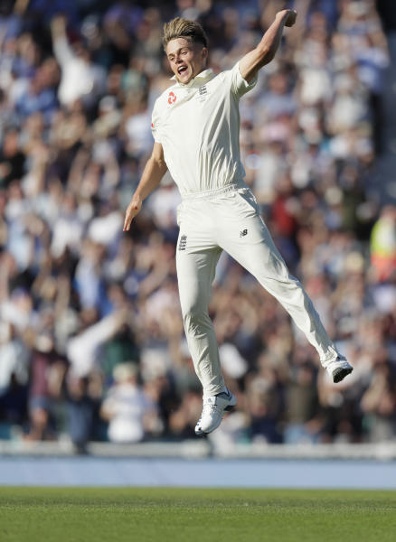 England's Sam Curran celebrates taking the wicket of Australia's Pat Cummins during the second day of the fifth Ashes test match between England and Australia at the Oval cricket ground in London, Friday, Sept. 13, 2019. (AP Photo/Kirsty Wigglesworth)