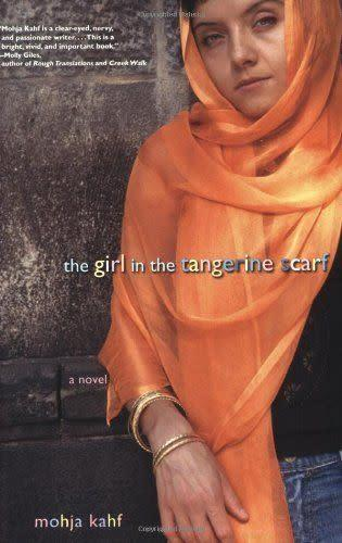 """<i><a href=""""http://www.amazon.com/Girl-Tangerine-Scarf-Novel/dp/0786715197/ref=sr_1_1?s=books&amp;ie=UTF8&amp;qid=1452630109&amp;sr=1-1&amp;keywords=Mohja+Kahf"""" rel=""""nofollow noopener"""" target=""""_blank"""" data-ylk=""""slk:The Girl In The Tangerine Scarf"""" class=""""link rapid-noclick-resp"""">The Girl In The Tangerine Scarf</a>&nbsp;</i>tells the story of&nbsp;Syrian immigrant Khadra Shamy growing up in a devout Muslim family in 1970s Indiana. The novel traces Khadra's journey&nbsp;through faith and identity-formation."""