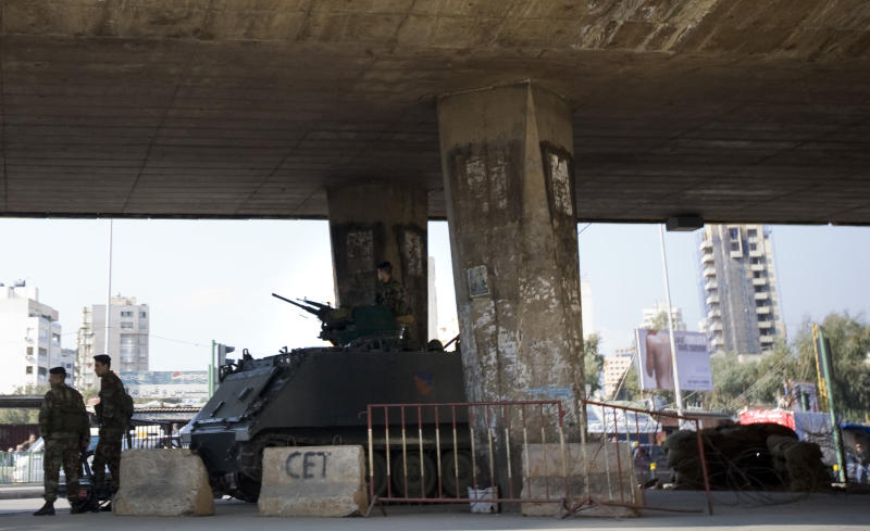 A Lebanese army tank takes up position under a bridge in Beirut, Lebanon, Wednesday, Jan. 19, 2011.  Saudi Arabia has abandoned efforts to mediate in Lebanon's political crisis, removing a key U.S. ally from talks to ease tensions after Hezbollah toppled the government in Beirut last week. (AP Photo/Grace Kassab)