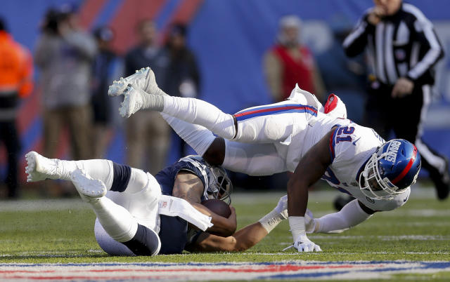 <p>Dallas Cowboys quarterback Zac Dysert (4) slides under New York Giants strong safety Landon Collins (21) during the second quarter of an NFL football game, Sunday, Dec. 10, 2017, in East Rutherford, N.J. (AP Photo/Adam Hunger) </p>