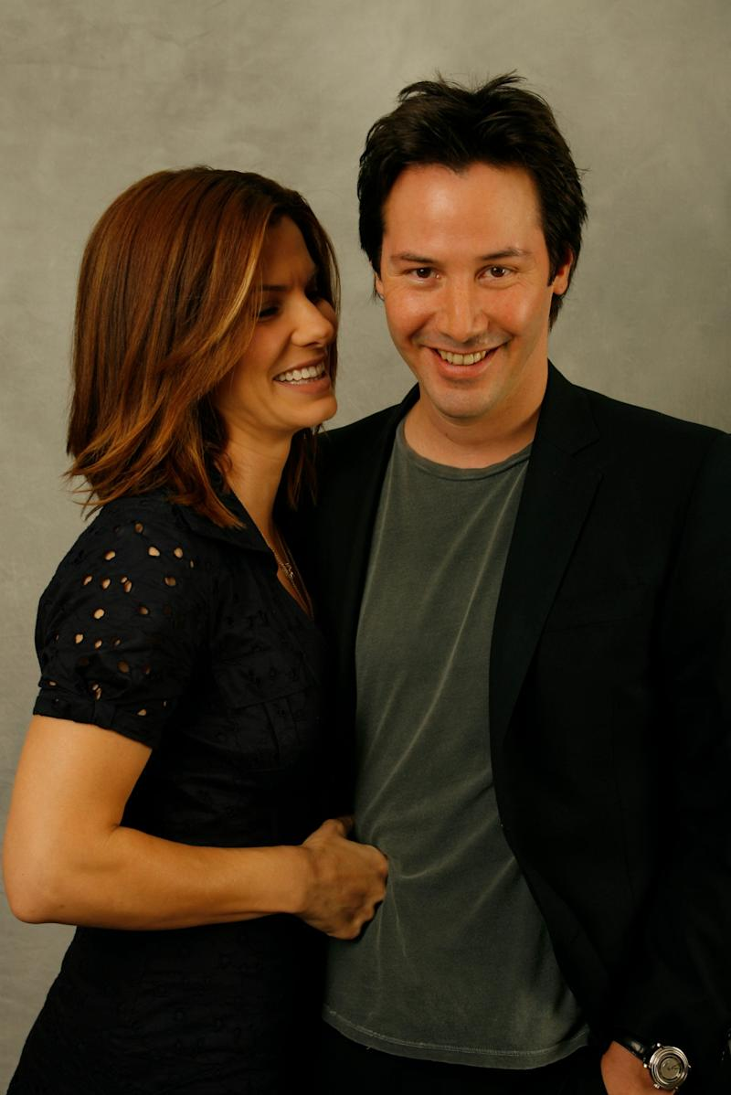 Keanu Reeves and Sandra Bullock have a laugh at a 2006 photo shoot with USA TODAY.