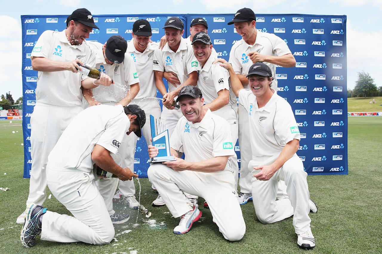 HAMILTON, NEW ZEALAND - DECEMBER 22:  New Zealand celebrate after winning the series on day four of the Third Test match between New Zealand and the West Indies at Seddon Park on December 22, 2013 in Hamilton, New Zealand.  (Photo by Hannah Johnston/Getty Images)