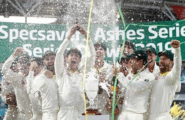 The Australian players celebrate after retaining the urn