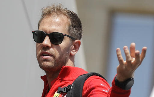 Ferrari driver Sebastian Vettel of Germany gestures before the first free practice at the Baku Formula One city circuit, in Baku, Azerbaijan, Friday, April 26, 2019. The Formula One race will be held on Sunday. (AP Photo/Sergei Grits)