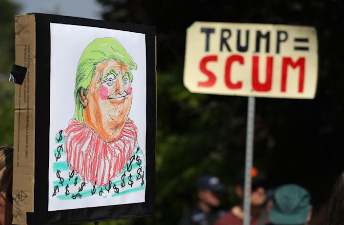Homemade anti-Trump placards in Butler's Cross, close to the primeminister's country residence of Chequers, during daytwo ofTrump's visit.
