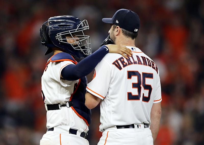 HOUSTON, TEXAS - OCTOBER 29: Justin Verlander #35 of the Houston Astros gets a mound visit from Robinson Chirinos #28 against the Washington Nationals during the fourth inning in Game Six of the 2019 World Series at Minute Maid Park on October 29, 2019 in Houston, Texas. (Photo by Elsa/Getty Images)