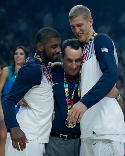 Mike Krzyzewski hugs former Duke players Kyrie Irving and Mason Plumlee after the gold-medal game. (Getty Images)