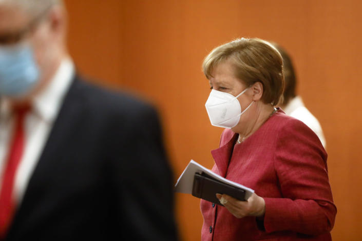 German Chancellor Angela Merkel arrives for the weekly cabinet meeting of the German government at the chancellery in Berlin, Tuesday, April 27, 2021. (AP Photo/Markus Schreiber, Pool)