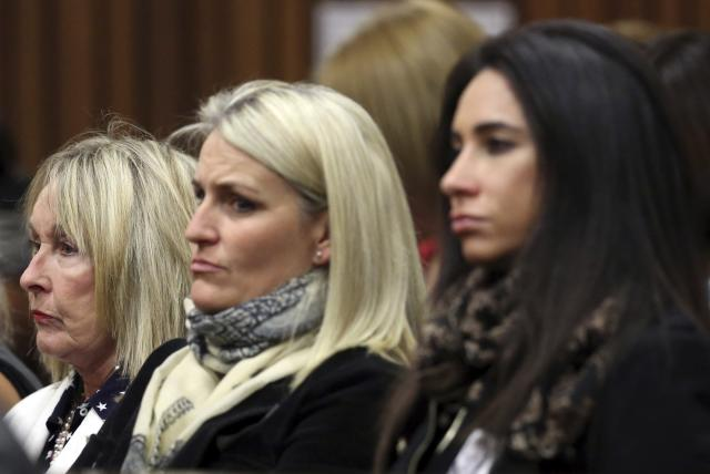 June Steenkamp (L), mother of Reeva Steenkamp, watches with family friends as Olympic and Paralympic track star Oscar Pistorius speaks in the North Gauteng High Court in Pretoria, April 11, 2014. Pistorius is on trial for murdering his girlfriend Reeva Steenkamp at his suburban Pretoria home on Valentine's Day last year. REUTERS/Themba Hadebe/Pool (SOUTH AFRICA - Tags: SPORT ATHLETICS CRIME LAW)
