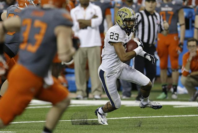 Pittsburgh punt returner Tyler Boyd (23) runs back a kick 54 yards for a touchdown during the first half of the Little Caesars Pizza Bowl NCAA college football game against Bowling Green, Thursday, Dec. 26, 2013, in Detroit. (AP Photo/Carlos Osorio)