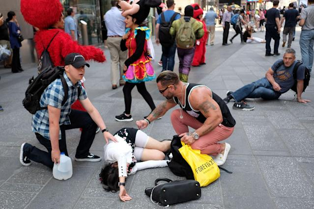 <p>People attend to an injured pedestrian a moment after a car plunged into them in Times Square in New York on May 18, 2017. (Jewel Samad/AFP/Getty Images) </p>