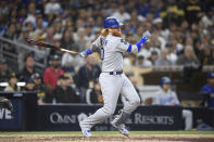 Los Angeles Dodgers' Justin Turner (10) hits an RBI single during the eighth inning of a baseball game against the San Diego Padres Wednesday, June 23, 2021, in San Diego. (AP Photo/Denis Poroy)