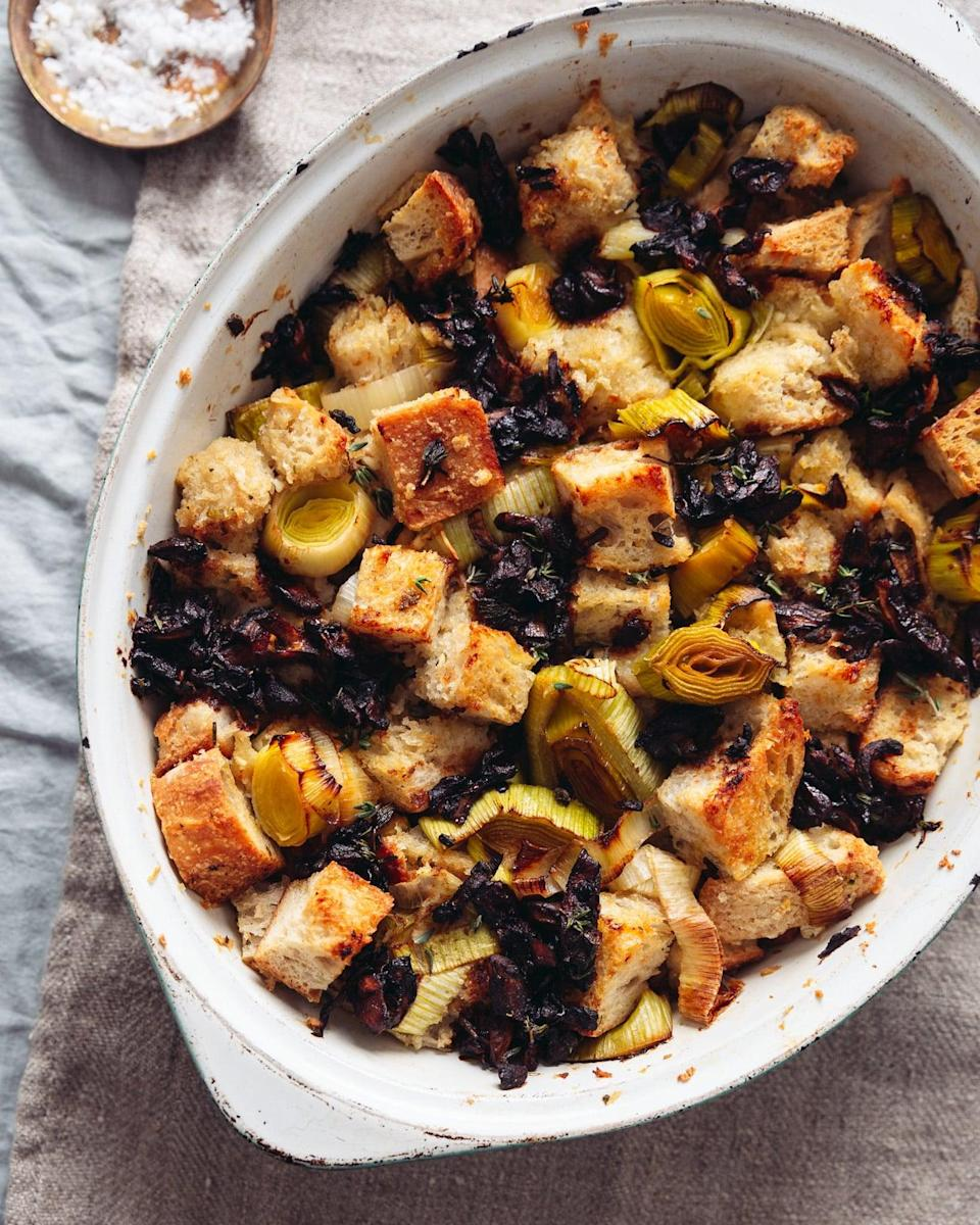 """<p>With ingredients like leeks, mushrooms, soy sauce, and sourdough bread, you really can't go wrong with this stuffing.</p> <p><strong>Get the recipe:</strong> <a href=""""http://topwithcinnamon.com/simple-garlicky-vegan-sourdough-stuffing/#jump"""" class=""""link rapid-noclick-resp"""" rel=""""nofollow noopener"""" target=""""_blank"""" data-ylk=""""slk:simple garlicky vegan sourdough stuffing"""">simple garlicky vegan sourdough stuffing</a></p>"""