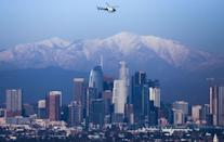 <p>Contrary to popular belief, you can spot snow from Los Angeles! The city skyline's backdrop shows a variety of gorgeous snow-capped mountains. </p>