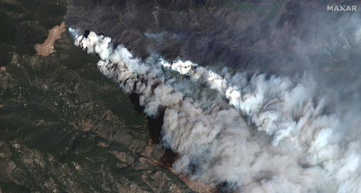 This handout satellite image released by Maxar Technologies shows the Cameron Peak Fire that continues to burn and spread dense smoke over the Front Range of northern Colorado on Oct. 16, 2020.