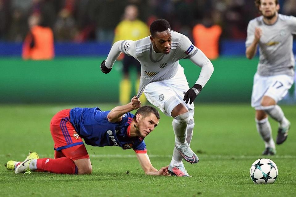 CSKA Moscow's Viktor Vasin (L) and Manchester United's Anthony Martial vie for the ball during their match in Moscow on September 27, 2017 (AFP Photo/Yuri KADOBNOV)