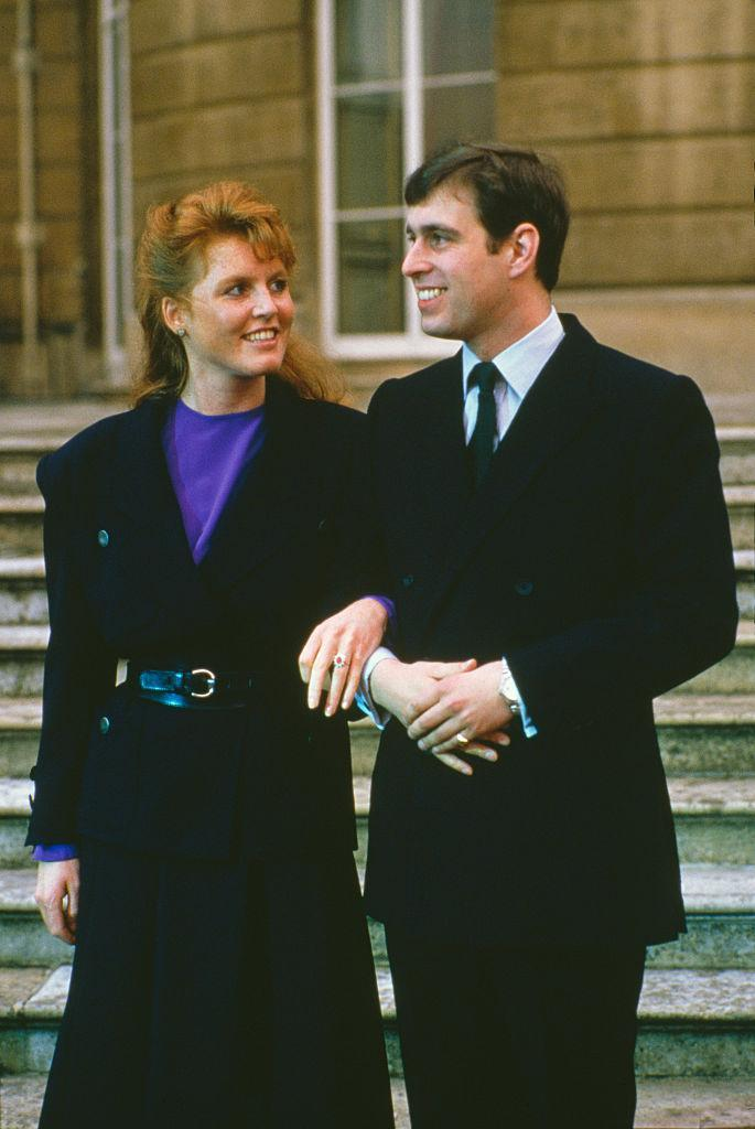 <p>Prince Andrew first met Sarah Ferguson when they were children and they began to date back in 1985. At the age of 26, the royal decided to propose and designed a ring with royal jewellers Garrard.<br><br>The ring featured a Burma ruby at the centre surrounded by ten drop-style diamonds.<br><br> Four months after the engagement, the couple wed on 23 July 1986 at Westminster Abbey. <em>[Photo: Getty]</em> </p>