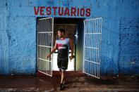 Striker Nicolas Caballero of the second division Resistencia football club, exits the club's locker room in Asuncion, Paraguay, Tuesday, Feb. 2, 2021. Caballero, 32, who hasn't been paid by his club for more than a year, now has a food stall that sells barbecue on the streets to survive during the COVID-19 pandemic. (AP Photo/Jorge Saenz)