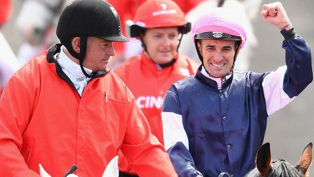 Jockey Corey Brown celebrates his second Melbourne Cup victory. Image: Getty