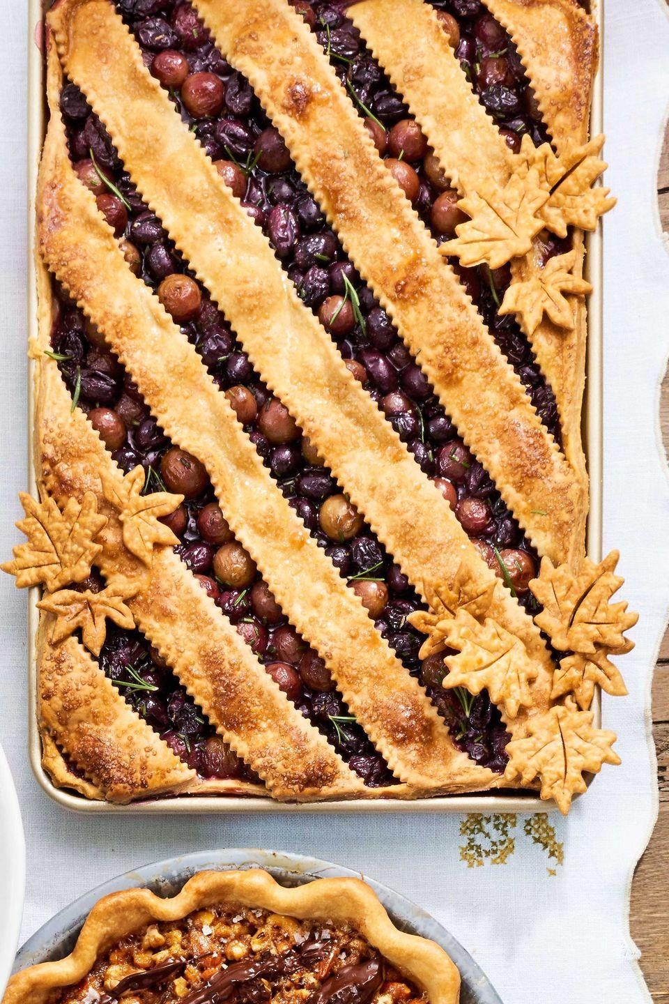 """<p>Feed a crowd with this rustic, sweet-and-savory pie.</p><p><strong><a href=""""https://www.countryliving.com/food-drinks/recipes/a40042/grape-slab-pie-recipe/"""" rel=""""nofollow noopener"""" target=""""_blank"""" data-ylk=""""slk:Get the recipe"""" class=""""link rapid-noclick-resp"""">Get the recipe</a>.</strong> </p>"""