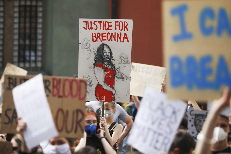 <p>And another protester calls her out by name, over a heartbreaking portrait.</p>