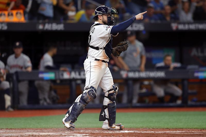 ST. PETERSBURG, FL - OCTOBER 08: Travis d'Arnaud #37 of the Tampa Bay Rays reacts after tagging out Jose Altuve #27 of the Houston Astros at home plate during the fourth inning of Game 4 of the ALDS between the Houston Astros and the Tampa Bay Rays at Tropicana Field on Tuesday, October 8, 2019 in St. Petersburg, Florida. (Photo by Mike Carlson/MLB Photos via Getty Images)