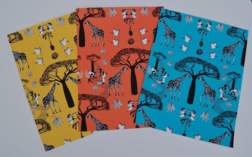 """Walls need love, and this wallpaper from Atlanta-based designer Elle Gibson, set against three vibrant background colors, delivers it in spades. The beautiful baobab trees and distinguished giraffes will bring a gorgeous texture to any room. $160, Elle Gibson. <a href=""""https://www.ellegibson.com/shop/7se6487lkjrdhubydengo3b8mv2lka?category=Wallpaper"""" rel=""""nofollow noopener"""" target=""""_blank"""" data-ylk=""""slk:Get it now!"""" class=""""link rapid-noclick-resp"""">Get it now!</a>"""