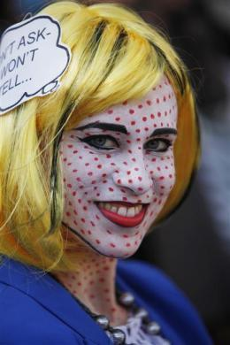 An Israeli dressed in a costume takes part in an annual parade for the Jewish holiday of Purim in the Israeli city of Holon, near Tel Aviv March 8, 2012.