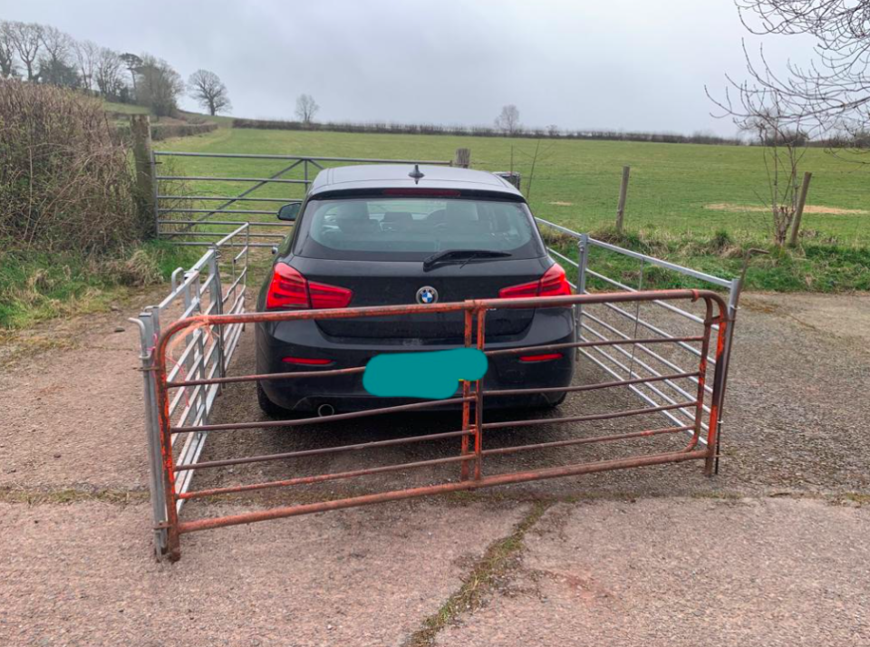 The farmer constructed a metal fence around the BMW after it blocked access to the field. (Wales News)